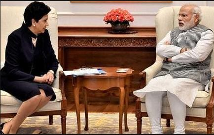 INDIRA NOOYI+PM MODI+1