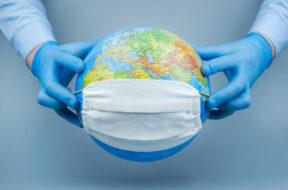 hands-medical-gloves-put-protective-mask-globe-world-coronavirus-corona-virus-attack-concept-concept-fight-against-virus_168508-455