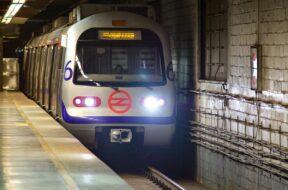 Subway train arrives at metro station of Delhi Metro system